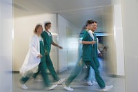 Physicians rushing through hospital Corridor side view motion blur
