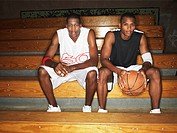 Basketball ball players sitting on bench portrait