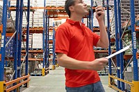 Warehouse Worker Using Walkie_Talkie