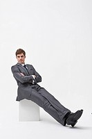 business man sitting on white box in various poses