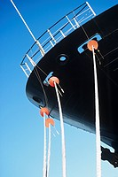 Ropes hanging from ship's bow close_up