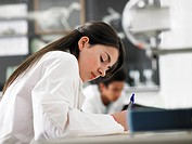 Teenager taking notes in science class (thumbnail)
