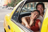 Couple in yellow taxi cab