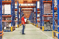 Man Walking Through Warehouse side view (thumbnail)