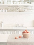 Brown Eggs in Bowl in White Kitchen