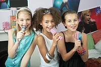 Girls using brushes microphones to sing at a Slumber Party (thumbnail)