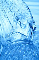Pouring water, close up, blue background