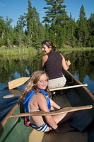 Mother and daughter on a canoe, Lake of the Woods, Ontario, Canada