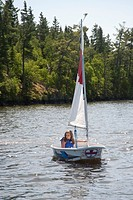 Young girl in small boat, Lake of the Woods, Ontario, Canada