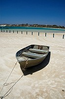 Boat moored in the sand