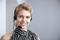 Businesswoman using telephone headset