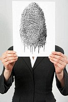 Businesswoman holding a fingerprint photo