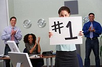 Office worker holding Number 1 sign
