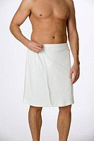 Young man wrapped in a towel