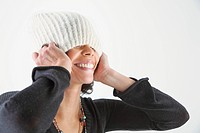 Playful woman with knit cap