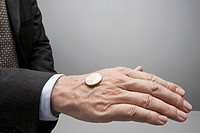 Businessman flipping coin