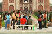 Photographers, professional and amateur, jockey for space on a bench in the center of the Taj Mahal reflecting pool in order to obtain souvenir pictur...