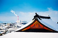 panoramic view of a temple roof covered by snow and blue sky background Takahashi , Kumamoto ,Kyushu , Japan