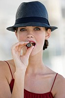 Fashion model smoking a cigar