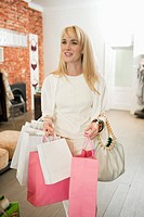 Woman holding shopping bags in a boutique
