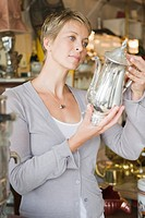 Woman holding a kettle in a store