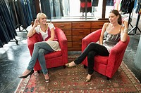 Two women sitting in a boutique