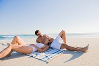 Couple lying on the beach