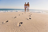 Couple standing on the beach (thumbnail)