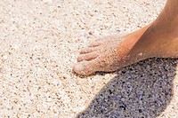 Close_up of a man's foot on sand