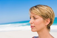 Close_up of a woman thinking on the beach