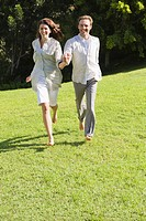 Couple running on grass (thumbnail)