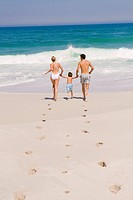 Family running on the beach (thumbnail)