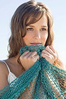 Close_up of a woman holding a net