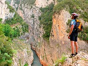 Mountain biker looking at Mont Rebei canyon  Lerida  Pyrenees  Catalonia  Spain