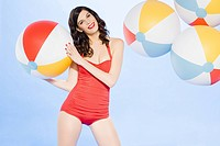 Young woman with beach balls (thumbnail)