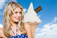 Young woman with giant ice cream cone