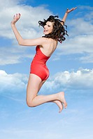 Woman in swimsuit jumping