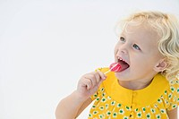 Girl licking red lollipop