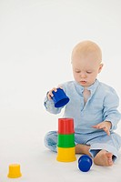 Baby boy stacking blocks