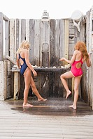Two girls under a beach shower