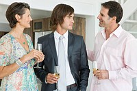 Man drinking champagne with his parents