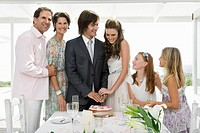 Newlywed couple with guests in a wedding party