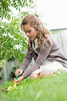 Girl gardening with a trowel (thumbnail)