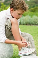 Boy tying his shoelaces