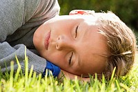 Boy napping on grass