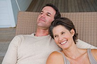 Couple resting on a porch swing