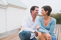 Couple smiling together in front of a house