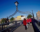 Ha'Penny Bridge, Dublin City, Ireland, People crossing pedestrian bridge