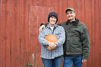 Farmer couple with pumpkin
