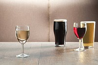 Wine and beer glasses on table in bar